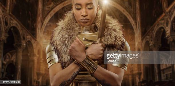 golden viking inspired warrior female in studio shot - period costume stock pictures, royalty-free photos & images