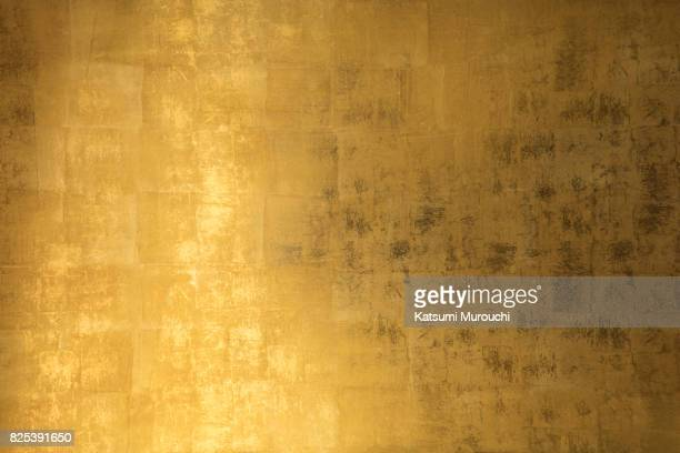 golden wall texture background - gold colored stock photos and pictures