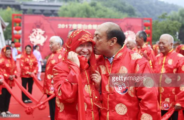 A 'golden wedding anniversary' ceremony is held for 86 elderly couples to celebrate their 50 years of marriage on the eve of the Qixi Festival...