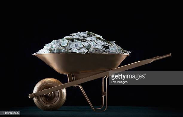 Golden wheel barrel of money