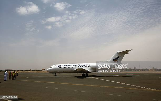 A Golden Wings aeroplane transporting Sudanese citizens arrives at the airport in Khartoum from Juba on July 15 2016 as Sudan began evacuating its...