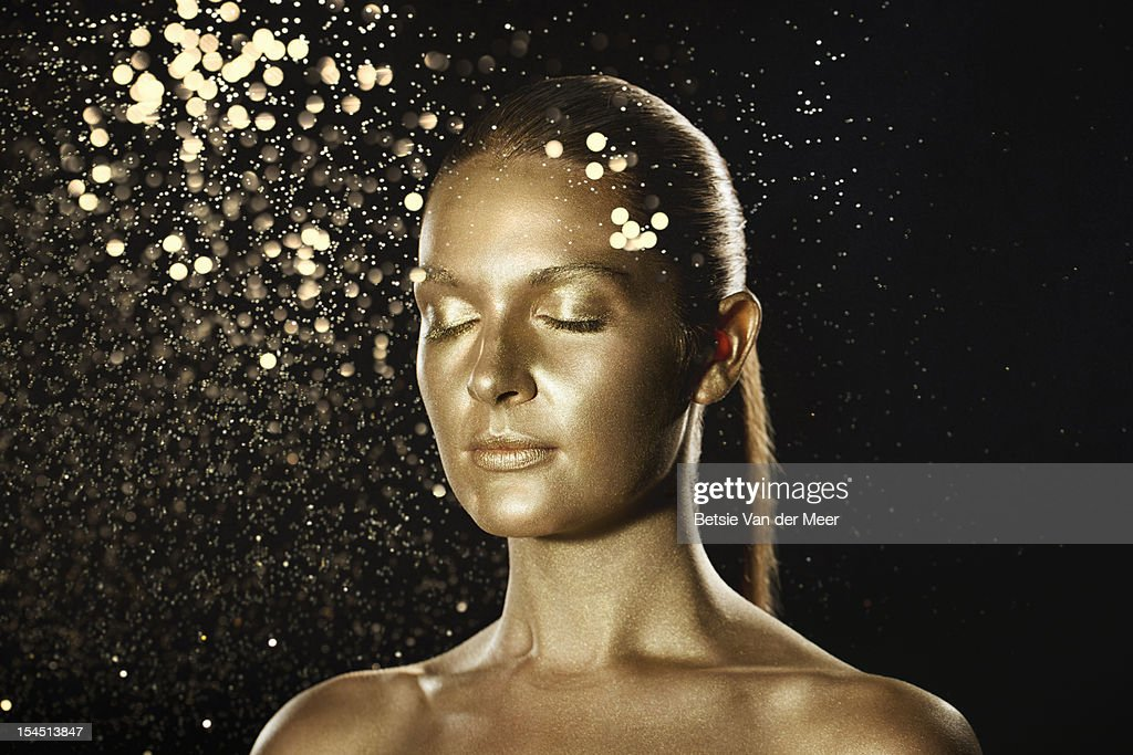 golden woman surrounded by sparkles. : Photo