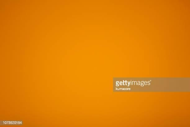 golden yellow colored paper - orange couleur photos et images de collection