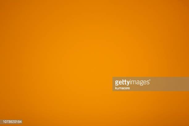 golden yellow colored paper - オレンジ色 ストックフォトと画像
