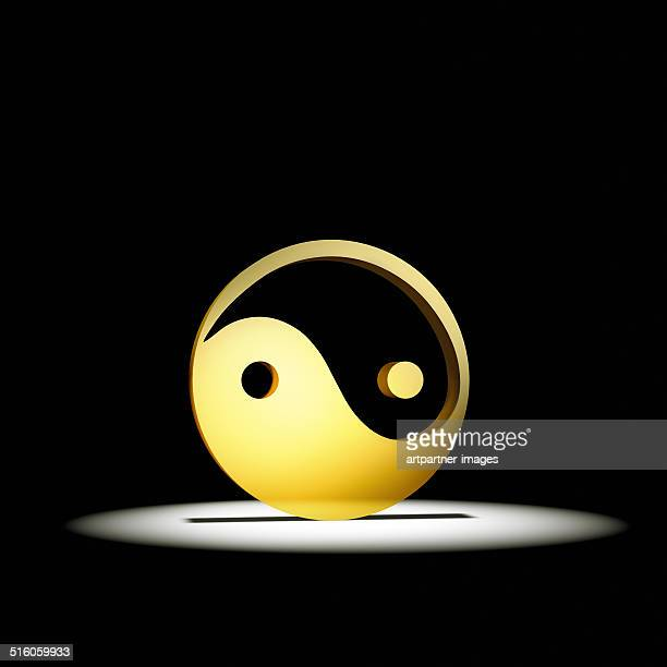 Golden Yin and Yang sign on black