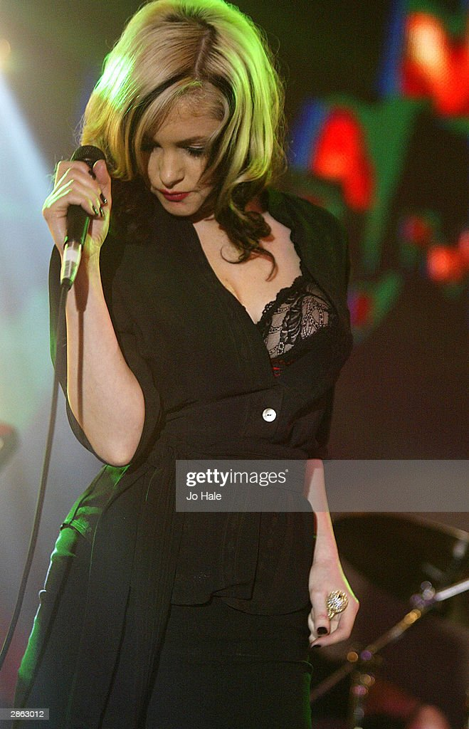 Goldfrappe perform live on stage at the announcement of the shortlist for The Brit Awards 2004 at the Park Lane Hotel on January 12, 2004 in London. The Brits Awards take place on February 17 2004.