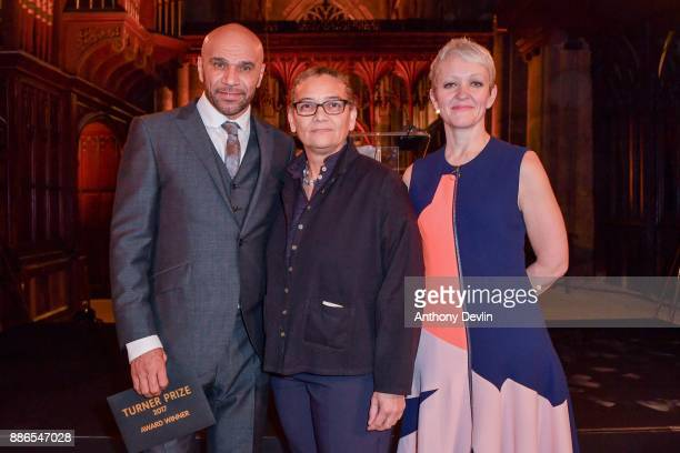 Goldie and Maria Balshaw Director of Tate pose with the winner of the Turner Prize 2017 Lubaina Himid at Hull Minster on December 5 2017 in Hull...
