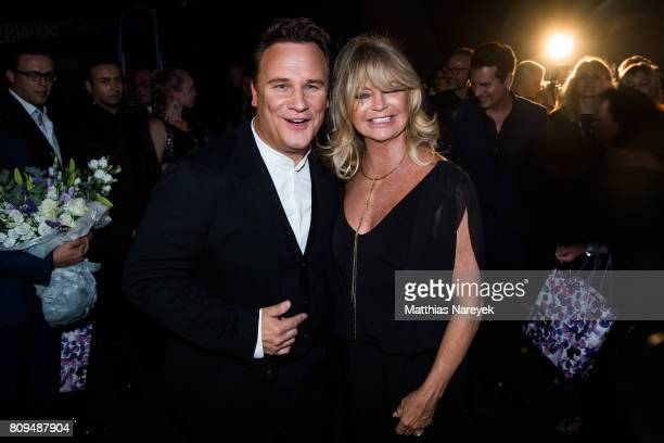 Goldie Hawn and Guido Maria Kretschmer attend the Guido Maria Kretschmer Fashion Show Autumn/Winter 2017 at Tempodrom on July 5 2017 in Berlin Germany