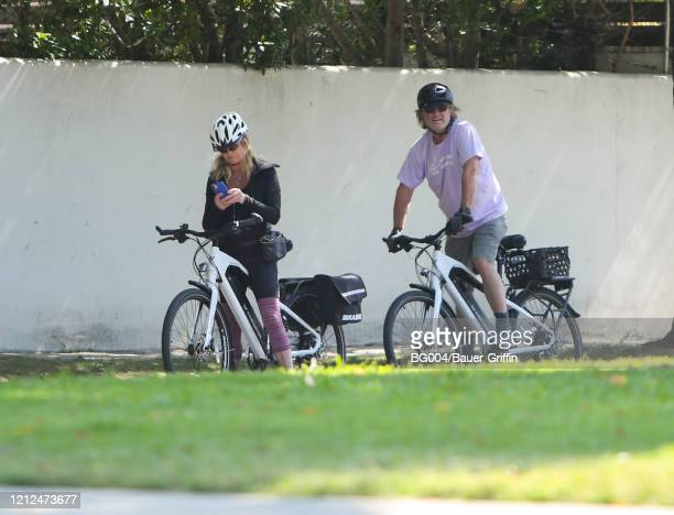Goldie Hawn and Kurt Russell are seen riding bicycles on May 10, 2020 in Los Angeles, California.