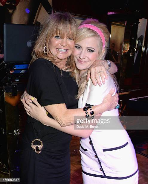Goldie Hawn and Pixie Lott attend a party at Annabel's hosted by Goldie Hawn on March 4 2014 in London England