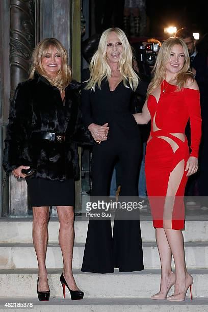 Goldie Hawn Donatella Versace and Kate Hudson attend the Versace show as part of Paris Fashion Week Haute Couture Spring/Summer 2015 on January 25...