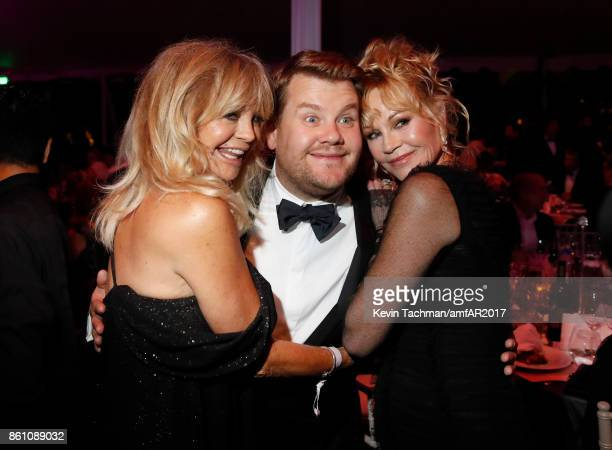 Goldie Hawn James Corden and Melanie Griffith at amfAR Los Angeles 2017 at Ron Burkle's Green Acres Estate on October 13 2017 in Beverly Hills...