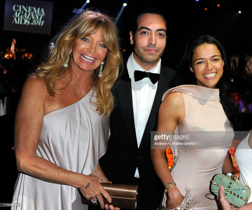 Goldie Hawn, Mohammed Al Turki, and Michelle Rodriguez attend amfAR's Cinema Against AIDS Gala during the 64th Annual Cannes Film Festival at Hotel Du Cap on May 19, 2011 in Antibes, France.