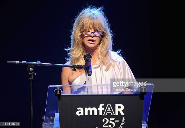 Goldie Hawn speaks onstage at amfAR's Cinema Against AIDS Gala during the 64th Annual Cannes Film Festival at Hotel Du Cap on May 19, 2011 in...