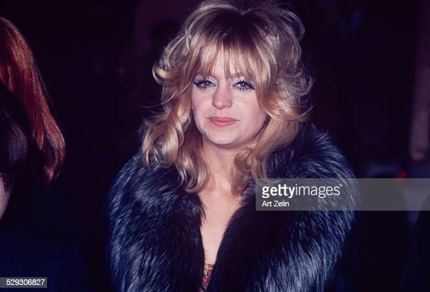 Goldie Hawn wearing a fur coat smiling for the photographer; circa 1970; New York.