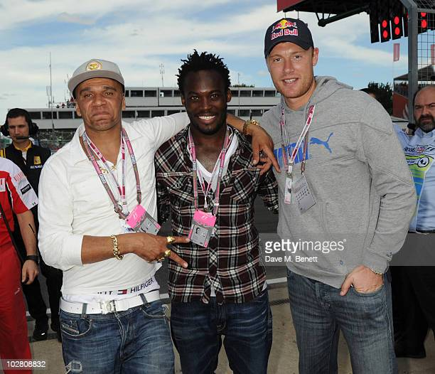 Goldie Michael Essien and Freddie Flintoff visit the F1 paddock during race day ahead of the Formula One British Grand Prix at Silverstone on July 11...