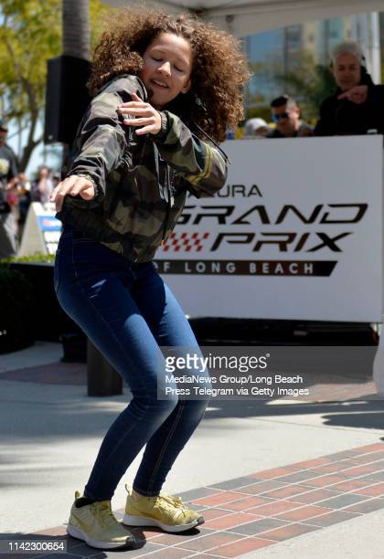 Goldilocks of Dance Masters showing her moves to the crowd gathered on day one of the 45th Acura Grand Prix of Long Beach in Long Beach on Friday...