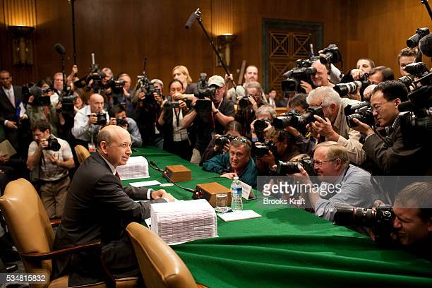 Goldman Sachs Chairman and CEO Lloyd Blankfein is surrounded by photographers as he arrive to testify before the Senate Homeland Security and...