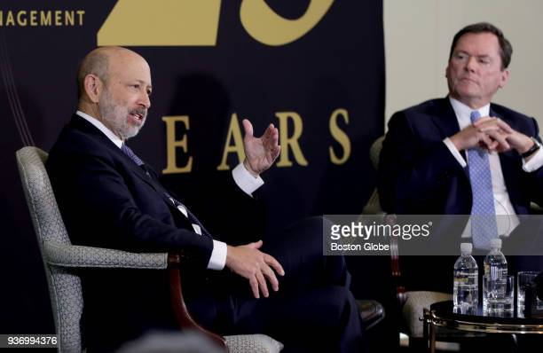 Goldman Sachs Chairman and CEO Lloyd Blankfein left speaks as host Joseph L Hooley III Chairman and Chief Executive Officer of State Street...