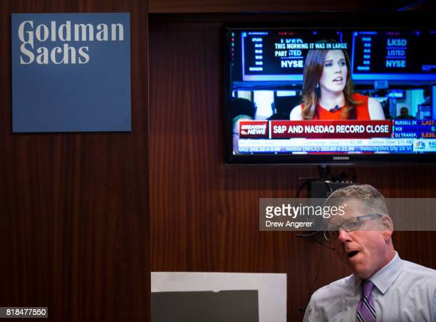 Goldman Sachs trader works at his desk on the floor of the New York Stock Exchange ahead of the closing bell July 18 2017 in New York City While the...