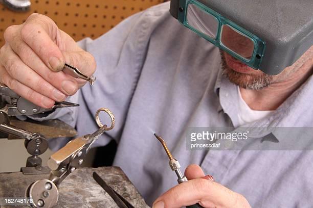 Goldsmith Using Torch