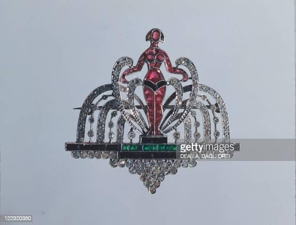 Goldsmith's art 20th century Art Deco female figure brooch set with rubies diamonds emeralds and sapphires