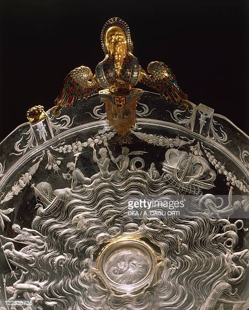 Goldsmith's art, Italy, 16th century. Rock crystal and enamelled gold cup. Height cm. 19. Milanese manufacture. Detail of the engraving depicting sea...