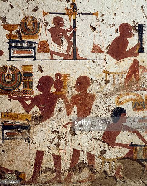 Goldsmiths busy weighing gold and presenting their products painted relief lower part of the southeast wall transverse chamber Tomb of Nebamon and...