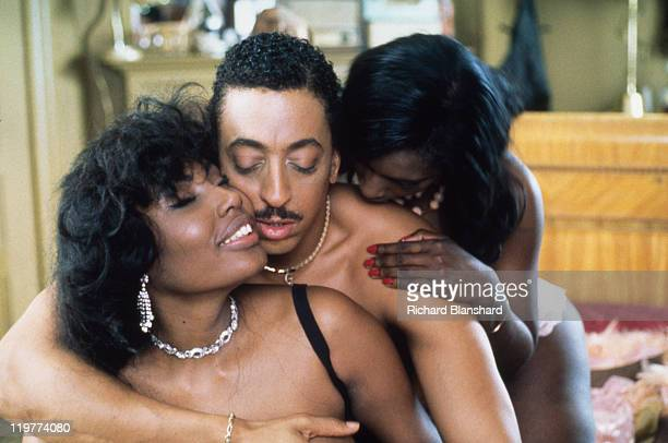 Goldy played by Gregory Hines enjoys the attentions of two ladies in a brothel scene from 'A Rage in Harlem' directed by Bill Duke 1991