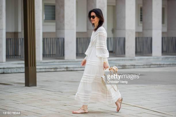 Golestaneh Mayer-Uellner is seen wearing white maxi dress Zimmermann, laced sandals Aquazzura, Hermès bag, scarf Chanel, sunglasses Celine on May 21,...