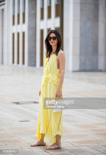 Golestaneh Mayer-Uellner is seen wearing yellow dress Victoria Beckham, laced sandals Aquazzura, white bag Chanel, sunglasses Celine on May 21, 2021...