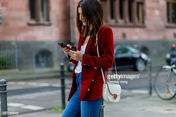 Golestaneh MayerUellner wearing a red velvet blazer from Balmain white Zara tshirt blue high waisted skinny jeans from Zara white Celine bag on June...