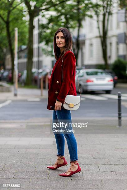 Golestaneh MayerUellner wearing a red velvet blazer from Balmain white Zara tshirt blue high waisted skinny jeans from Zara red lace up ballerinas...