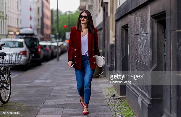 Golestaneh MayerUellner wearing Celine sunglasses a red velvet blazer from Balmain white Zara tshirt blue high waisted skinny jeans from Zara red...