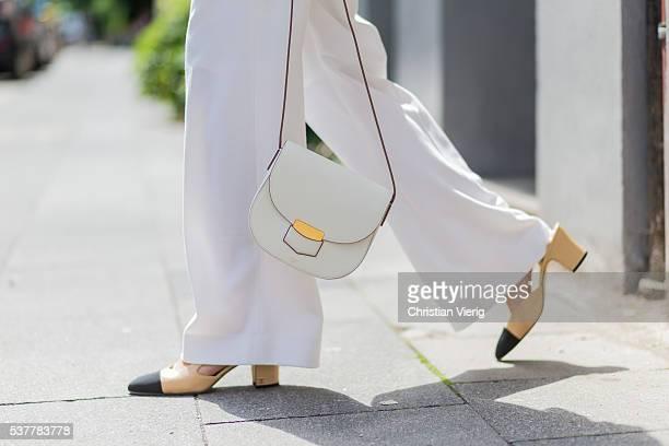 Golestaneh MayerUellner wearing white wide leg pants from Fall Winter Spring Summer Slingbacks from Chanel as shoes white Celine bag on June 2 2016...