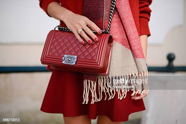 Golesthameh MayerUellner poses wearing a Zara jumper Golestameh skirt and scarf and Chanel bag on September 27 2014 in Paris France