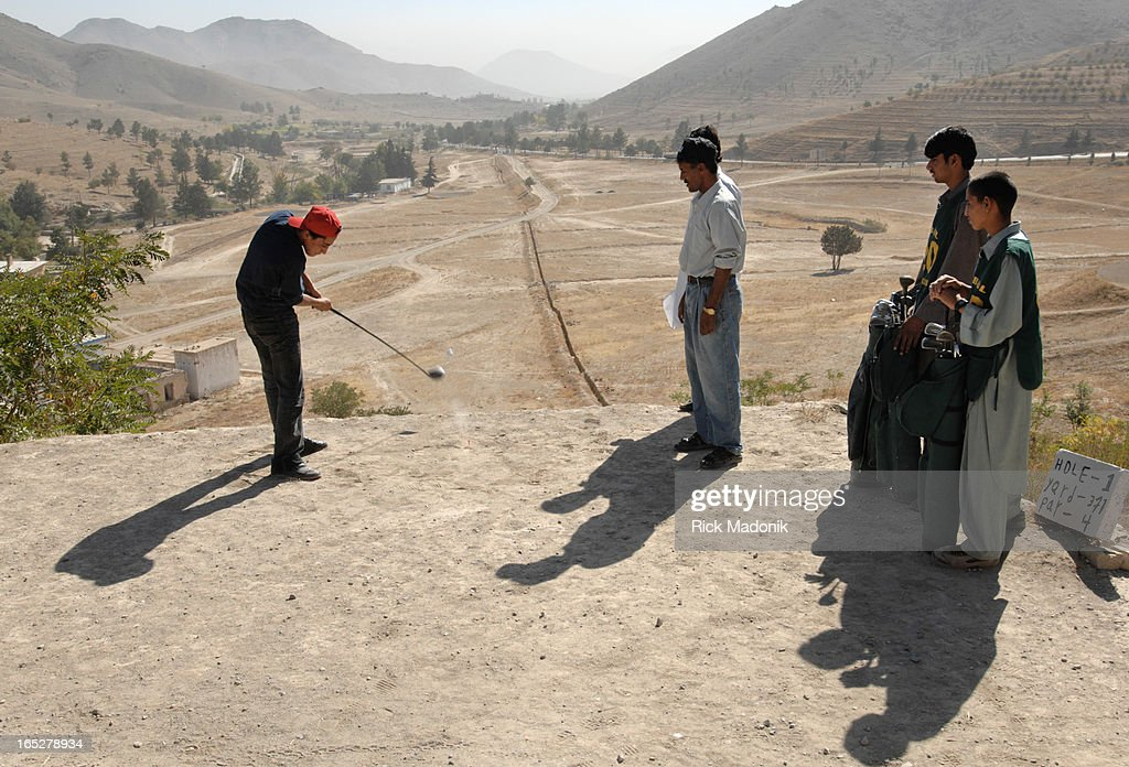 golf - 10/04/06 - KABUL, AFGHANISTAN - Naween, 18, hits from the tee box of the 1st hole, a 371 yard : News Photo