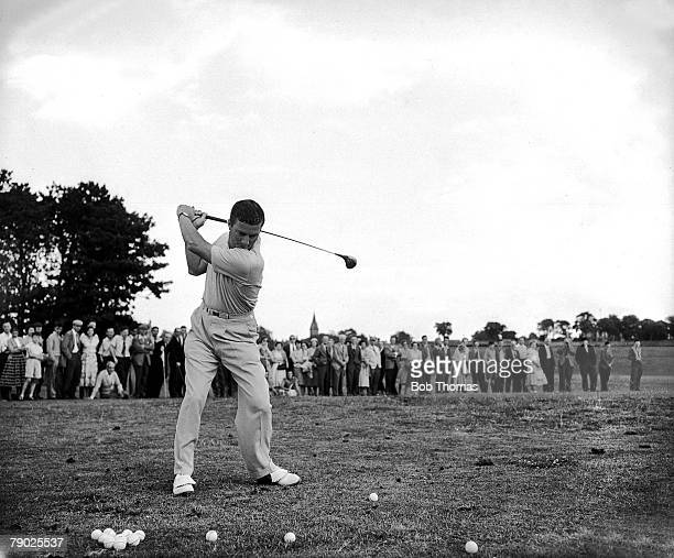 1957 St Andrews British Open Championship Australian legend Peter Thomson takes a swing at the ball while being watched by a large crowd