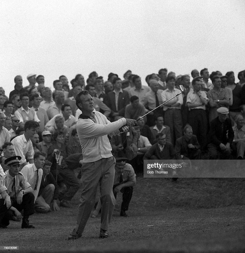 Golf. 1962 British Open Golf Championship. Royal Birkdale, Lancashire. U.S.A's Arnold Palmer hits a lofted approach shot. : News Photo