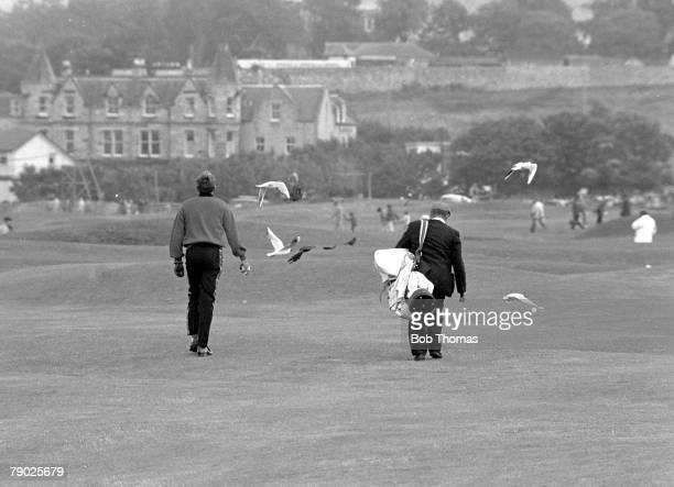 Golf 1970 British Open Championship at St Andrews A picture of Doug Sanders of the USA walking with his caddie as he gets a birdie before he lost to...