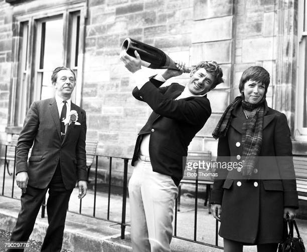 Golf 1970 British Open Championship at St Andrews A picture of Doug Sanders of the USA with his wife holding up a large bottle of champagne after he...