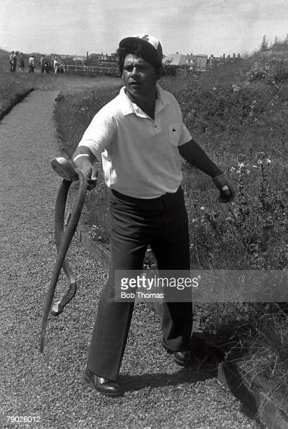 Golf, 1971 British Open Golf Championship, Royal Birkdale, July America's Lee Trevino holds a snake on the end of his club as he searches for his...