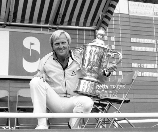 Golf 1983 Suntory World Match Play A picture of the champion Greg Norman of Australia holding the trophy