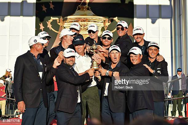 41st Ryder Cup Team USA captain Davis Love III victorious holding trophy with teammates after winning tournament on Sunday at Hazeltine National GC...