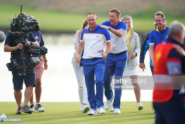 42nd Ryder Cup Team Europe Alex Noren victorious with Ian Poulter after winning Sunday Singles and tournament at Le Golf National Paris France...