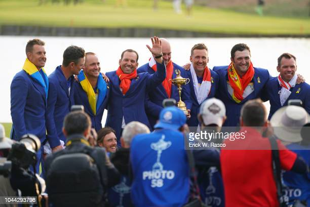 42nd Ryder Cup Team Europe captain Thomas Bjorn and team members victorious with trophy after winning Sunday Singles and tournament at Le Golf...