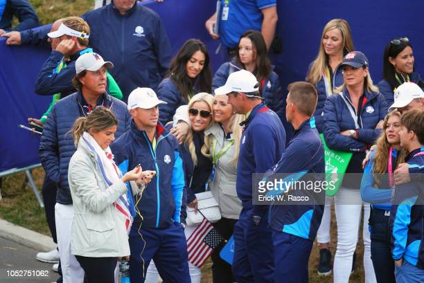 42nd Ryder Cup Team Europe ViceCaptain Padraig Harrington's wife Caroline hugging Team USA Phil Mickelson's wife Amy during Friday play at Le Golf...