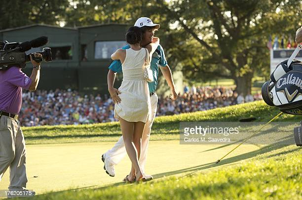 95th PGA Championship Jason Dufner victorious after making tournament winning bogey putt on No 18 with wife Amanda Dufner during Sunday play at Oak...