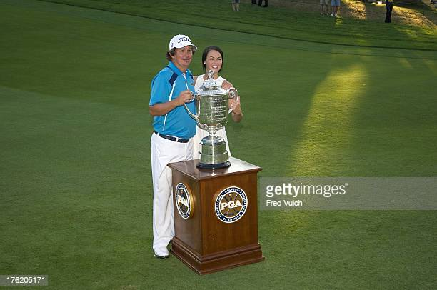 95th PGA Championship Jason Dufner victorious holding Rodman Wanamaker Trophy with wife Amanda Dufner after winning tournament on No 18 during Sunday...