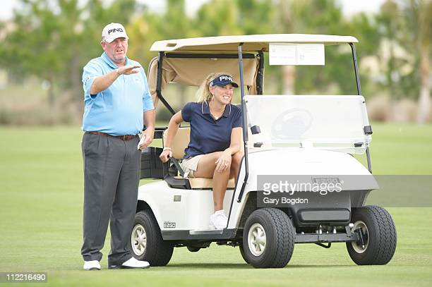 ACE Group Classic Mark Calcavecchia on course while his caddie wife Brenda Calcavecchia sits in golf cart during Friday play at Golf Lodge at the...